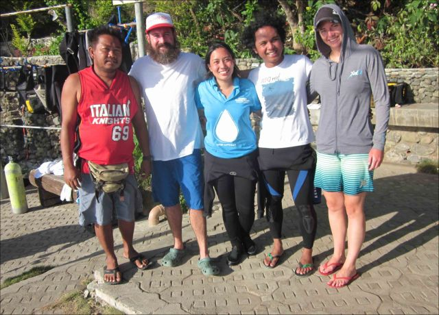 After a day of checking instruments and collecting water samples at monitoring stations in the Verde Island Passage, Philippines, (left to right) Joury of the Bantay Dagat, Max Sudnovsky of the PIFSC Coral Reef Ecosystem Division (CRED), Aya Cariño and Diovanie De Jesus of the University of the Philippines Marine Science Institute, and Adel Heenan of CRED stand outside of Planet Dive on Feb. 3. NOAA photo