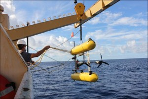 John Rooney and other cruise staff deploy a SeaBED autonomous underwater vehicle from the NOAA Ship Oscar Elton Sette to assess bottomfish abundance. NOAA photo