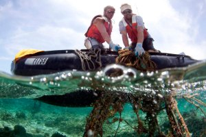 Kevin O'Brien and Brian Yannutz remove derelict fishing gear from a reef at Midway Atoll. NOAA photo