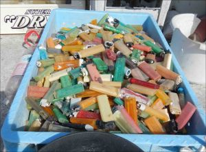 The contents of this plastic crate make up just a portion of the 1249 cigarette lighters found on the shorelines of Midway Atoll during this mission. NOAA photo by Kristen Kelly
