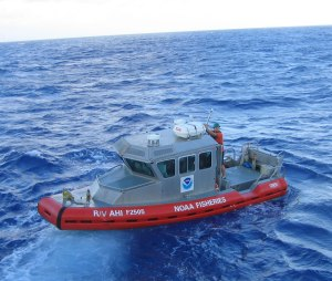 The NOAA R/V AHI, an 8-m survey launch, will be used to map seafloor depths around O`ahu from June 17 to July 3. NOAA photo