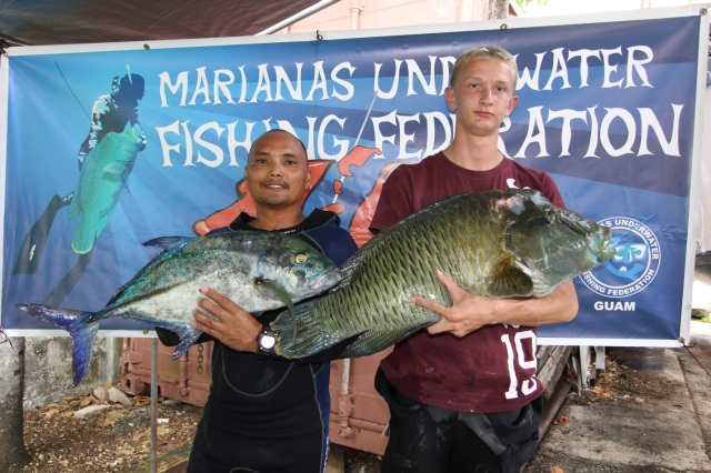 Ken Quan and Gavin Simmons holding their 1st place catch, a Napoleon Wrasse (Cheilinus undulatus) and a Bluefin Trevally (Caranx melampygus) with a combined weight of 36.25lbs.  Photo Credit: James Borja