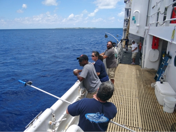 Scientists and crew on the NOAA Ship Oscar Elton Sette preparing for the days operations.  From front to back: Tommy Knowles, Ray Storms, Stephanie Koes (The Commanding Officer of the Oscar Elton Sette), Eric Mooney, Eric Breuer, and Justin Kantor.