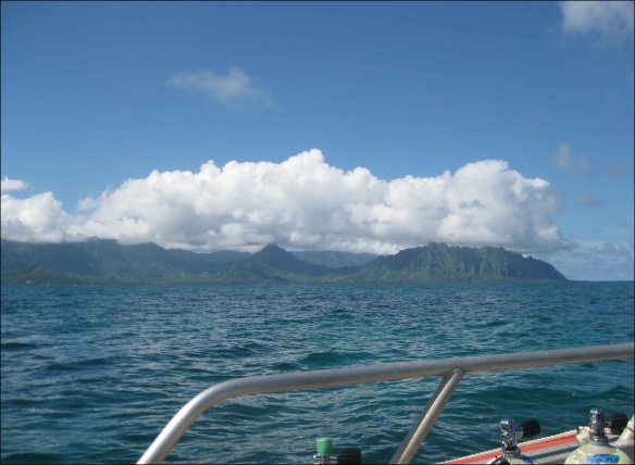 Panoramic view of Kaneohe Bay, on the eastern coast of O`ahu, as seen from a small boat on Oct. 20 during a two-week mission (SB-13-20) to conduct monitoring surveys of coral reef ecosystems. NOAA photo by Brett Schumacher