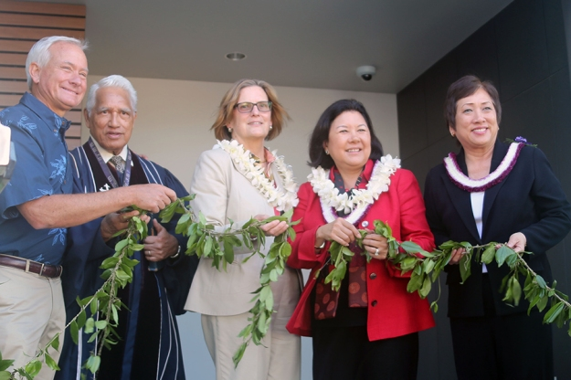 Maile lei untied signifying opening of the IRC
