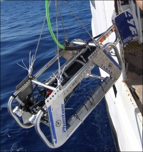 The video and still photographs collected by the towed optical assessment device (TOAD), the camera sled shown being deployed from a ship in this photo, can be analyzed to help map the character of benthic habitats. NOAA photo
