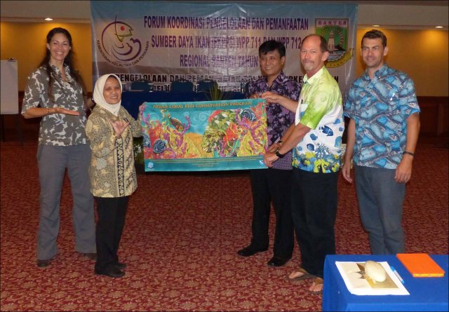 During the workshop in Banten, Indonesia, Dr. Toni Ruchimat, Director of the Directorate of Fisheries Resources (SDI) of Indonesia's Ministry of Marine Affairs and Fisheries, and NOAA team members Rusty Brainard, Jason Philibotte, and Megan Moews-Asher present Ibu Erni Widjajanti, who is the fisheries management plan (RPP) team lead, with a NOAA Coral Reef Conservation Program banner as a token of appreciation for all of her hard work, leadership, and drive. NOAA photo