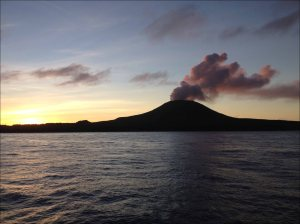 The volcano on the island of Pagan emits plumes of gas and steam on the evening of April 20, as seen in this photo taken during the PIFSC cruise HA-14-01. NOAA photo