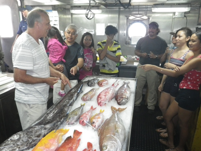 Chief Scientist Robert Humphreys talks with visitors about the fish on display and the value in understanding the life history of targeted fish species