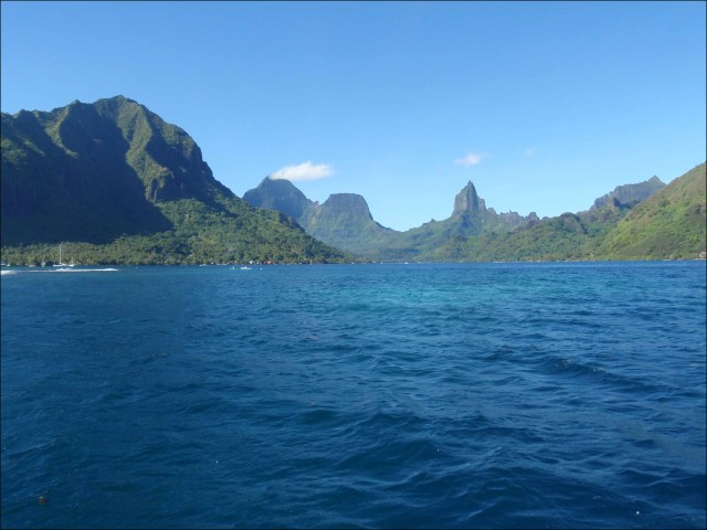 A wide shot of Opunohu Bay on the north shore of Mo'orea, French Polynesia, with striking pinnacles in the background, as seen from the R/V AHI on Aug 1. NOAA photo by Kevin O'Brien