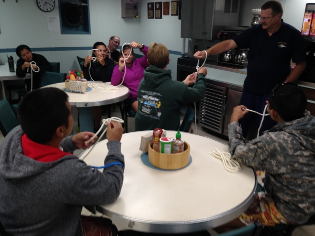 Small boat coxswain and boating teacher Jamie Barlow teaches UOG students a knot-tying class.