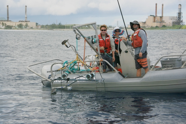 NOAA Scientists, from left to right, Jamie Barlow, Louise Giuseffi and Jake Asher pose with a stereo-BRUVs