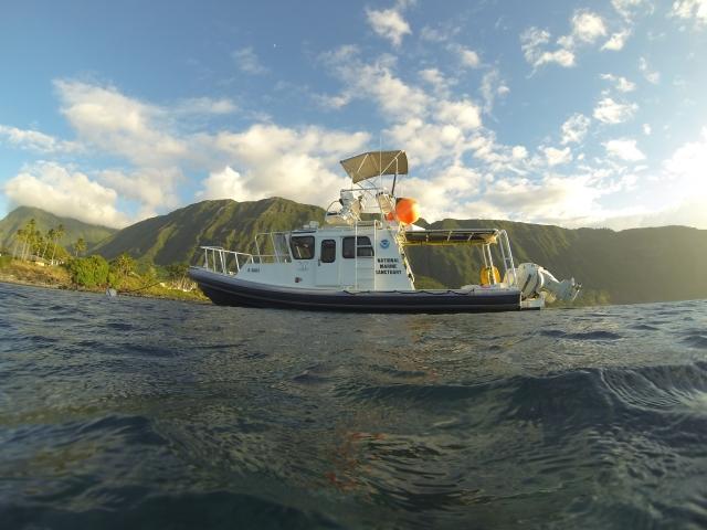 Koholā moored just off the Kalaupapa settlement. Photo by Ed Lyman.