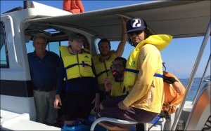 Robert Crean of Compass Charters, Molly Timmers of the PIFSC Coral Reef Ecosystem Division (CRED), Lloyd Lee of Dive Timor Lorasae, Rui Pinto of Conservation International, and Charles Young of CRED arrive on Sept. 16 at Atauro Island, Timor-Leste, on the Lancet, a charter vessel. NOAA photo