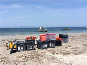 Scientific equipment gets off-loaded from the Lancet for land-based operations. NOAA photo