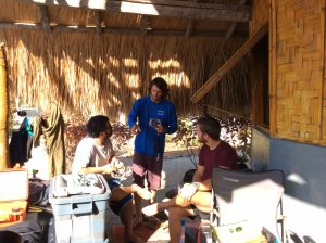 Charles Young (middle) briefs Rui Pinto from Conservation International and Lloyd Lee from Dive Timor Lorasae on the protocol for taking still photographs (photoquadrats) to record the benthos at set intervals along two 25-m transect lines. NOAA photo