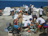 Marine debris team working hard to sort through the various types of debris collected from shoreline surveys on Eastern and Spit Island. The team removed approximately 3,435kg of derelict fishing gear and plastics in a single day of operations.