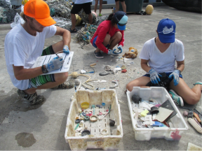 Kevin O'Brien and crew tally up the numerous types of plastics that were collected from Eastern and Spit Island.