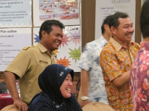 Participants and trainers share a laugh during the Padang workshop.