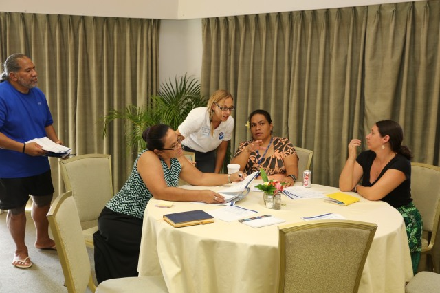 Workshop participants discussing community outreach and scientific collaborations during a public session