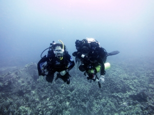 Closed circuit rebreather (CCR) diver Ray Boland poses with open circuit diver Kristin Golman despite her loud and annoying exhales.