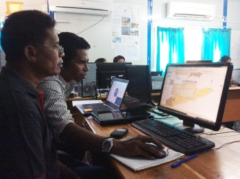 Workshop participants navigate a geographic information system with the coral reef data NOAA collected for Timor-Leste.