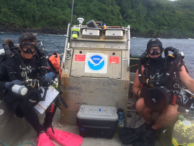 Figure 1: Ray Boland and Tate Wester pose for a picture; all gear up, cameras in hand, and in moments will roll out of the boat to start their reef fish survey.