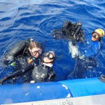 As part of the training, divers practice emergency drills, such as rescuing an unconscious diver.
