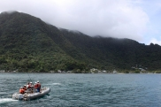 Small boat heads into Pago Pago, American Samoa, NOAA Photo by Ray Boland.