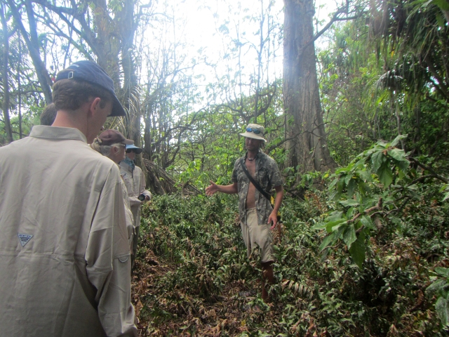 Refuge Manager Stefan Kropidlowski talks with the group about the native Pisonia tree behind him.