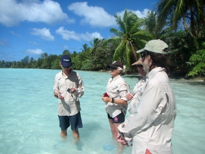 Sean Russell, Susan White, Callum Roberts and Leanne Fernandes discuss marine conservation while wading through the water at Palmyra Atoll.