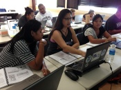 Guam and Palau participants during a hands-on group exercise on Linear Regression
