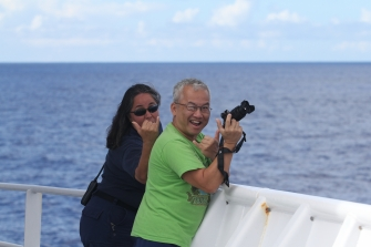 CDRs Koes and Tran step outside to watch whales near the bow of the Sette. Photo credit: NOAA Fisheries/Amanda Bradford